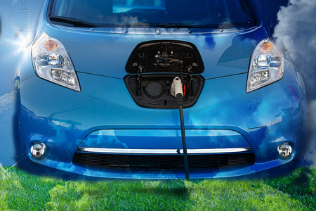 Photo for Electric Hybrid Car, plugged in - Royalty Free Image