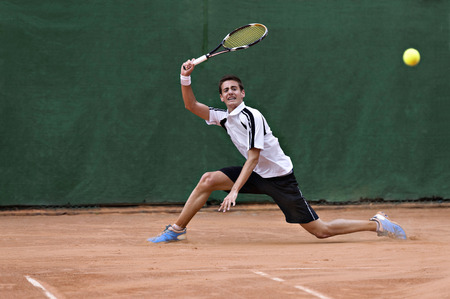 Young, playing tennis