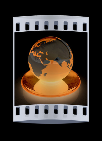 Globe on a saucer on a black background. The film strip