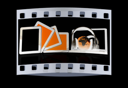 headphones and  earth on the  laptop and tablet pc on a black background. The film strip