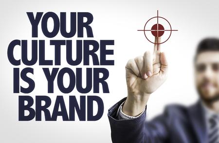 Photo pour Business man pointing the text: Your Culture is Your Brand - image libre de droit