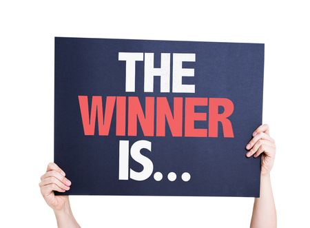Foto de The Winner Is... card isolated on white - Imagen libre de derechos