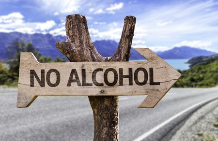 Foto de No alcohol sign with arrow on road background - Imagen libre de derechos