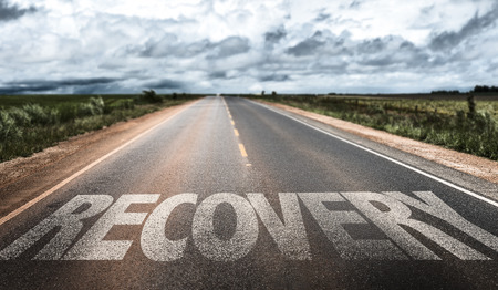 Foto de Recovery written on the road - Imagen libre de derechos