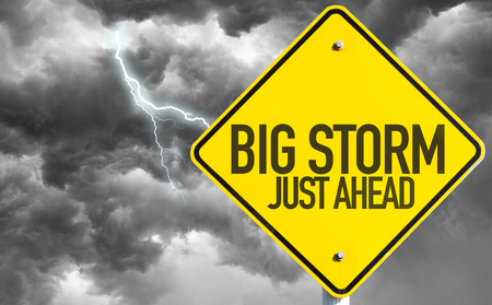 Big storm just ahead sign with gloomy clouds and sky background