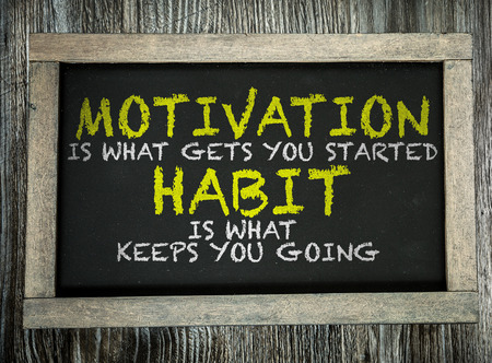 Foto per Motivation is What Gets You Started Habit Is What Keeps You Going written on chalkboard - Immagine Royalty Free