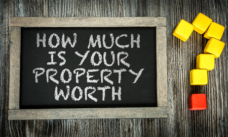 Foto de How Much is Your Property Worth written on chalkboard - Imagen libre de derechos
