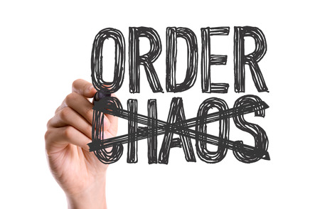 Photo pour Hand with marker writing the word Order Chaos - image libre de droit
