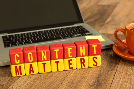 Photo for Content Matters written on a wooden cube in front of a laptop - Royalty Free Image