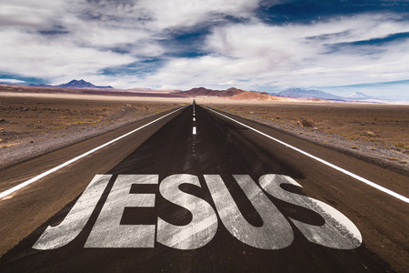 Photo pour Jesus written on desert road - image libre de droit