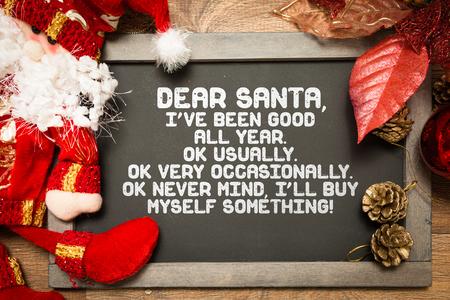Photo pour Blackboard with a Christmas Funny text in a conceptual image - image libre de droit