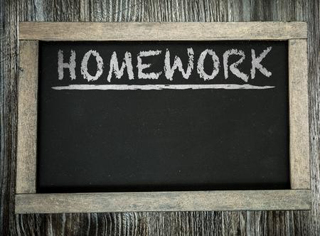 Photo for Homework written on chalkboard - Royalty Free Image