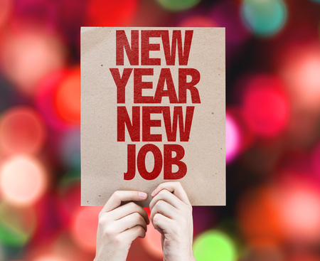 Photo for Hands holding cardboard on bokeh background with text: New year new job - Royalty Free Image