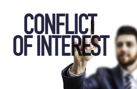 Photo for Business man pointing to transparent board with text: Conflict of interest - Royalty Free Image