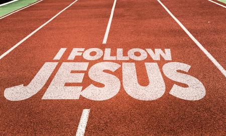 Photo pour I follow Jesus written on running track background - image libre de droit
