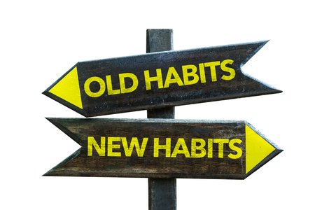 Foto per Old habits/new habits sign with arrow on white background - Immagine Royalty Free