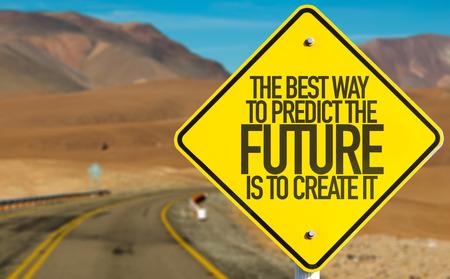 Foto de The best way to predict the future is to create it sign with desert background - Imagen libre de derechos