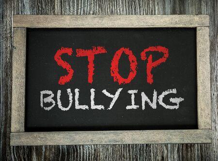 Foto de Stop bullying words on a blackboard - Imagen libre de derechos