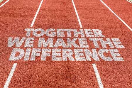 Foto de Running track with the words Together We Make The Difference - Imagen libre de derechos