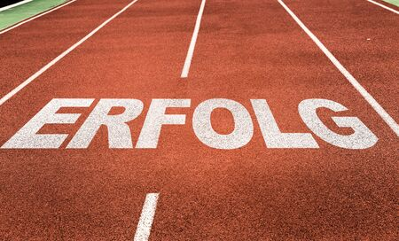Running track with the word Erfolg
