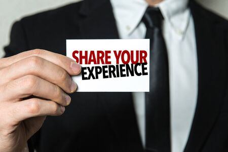 Photo for Man holding share your experience card - Royalty Free Image