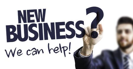 Photo for Man pointing at the words we can help with new business - Royalty Free Image
