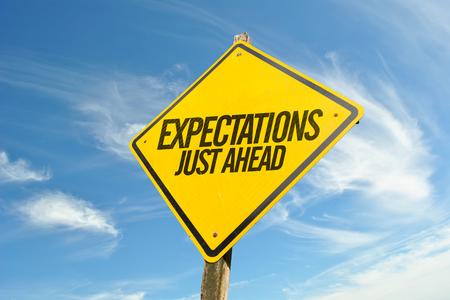 Foto de Expectations Just Ahead road sign - Imagen libre de derechos