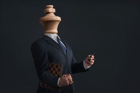Photo pour Symbol of a Headless Narcissist with pawns in the hands - image libre de droit