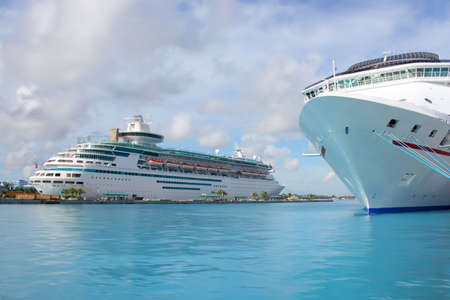 Cruise ships in the clear blue Caribbean ocean docked in the port of Nassau, Bahamas