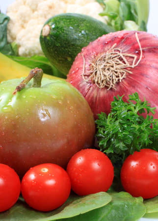 Group of wet with dew drops fruits and vegetables like grapes tomatoes, apple, red onion