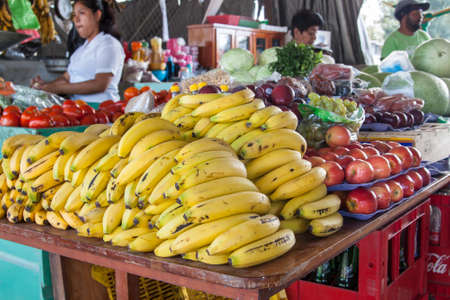 San Ignacio, Belize - March 1, 2017:  market in San Ignacio, Belize selling vegetables and fruit like bananas, apples and tomatoes