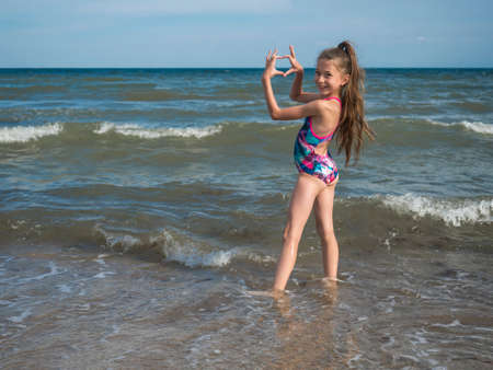 Photo for A teenage girl in a bathing suit, swims in the sea. The concept of a healthy lifestyle - Royalty Free Image