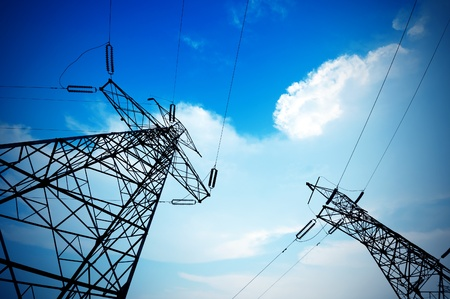 Foto de Electricity pylon against blue cloudy sky - Imagen libre de derechos