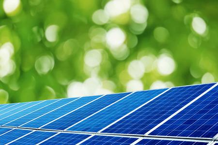 Photo pour Solar panels under the trees background - image libre de droit