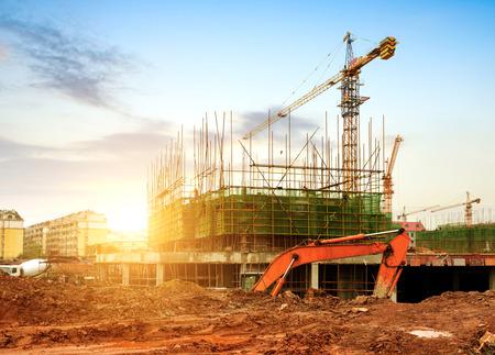Foto per Construction site, workers and cranes. - Immagine Royalty Free