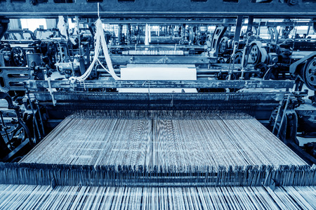 Foto de Thread from weaving machine, Abstract background - selective focus. - Imagen libre de derechos