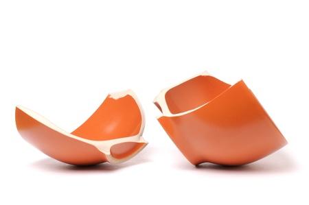 Broken orange plate isolated on white background