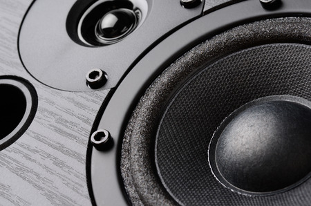 Photo for Multimedia speaker system with different speakers closeup over black background - Royalty Free Image
