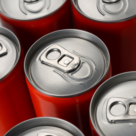 Foto de Group of red aluminum soda or cola cans top view - Imagen libre de derechos