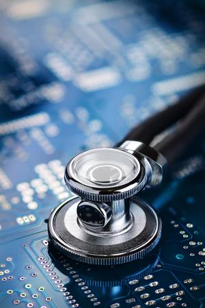 Foto für Stethoscope on the blue printed circuit board. Repair diagnostic fixing electronic concept - Lizenzfreies Bild