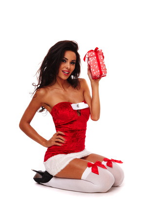 Photo for santa helper girl on white background with long hair and red gift box - Royalty Free Image