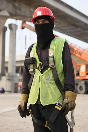Immigrant Asian Construction Worker In A Construction Zone