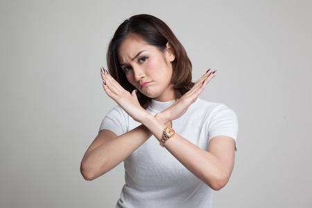 Foto de Beautiful young Asian woman say no on gray background - Imagen libre de derechos