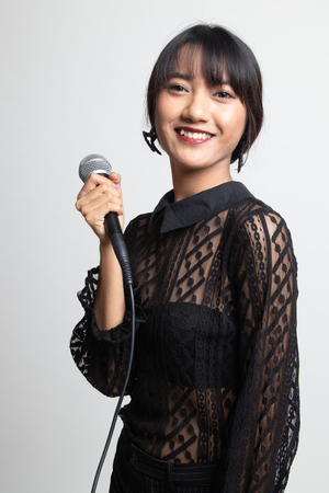 Photo for Portrait of beautiful young asian woman singer sing with microphone on white background - Royalty Free Image