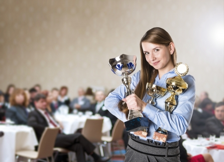 Foto de Young business woman was awarded on corporate conference  - Imagen libre de derechos