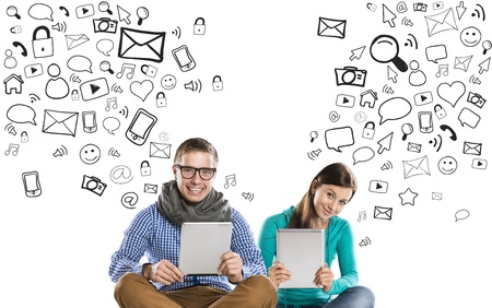 Photo for Beautiful young couple with tablets is using social media - Royalty Free Image