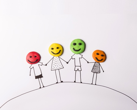 Foto de Happy family concept with heads from play dough - Imagen libre de derechos