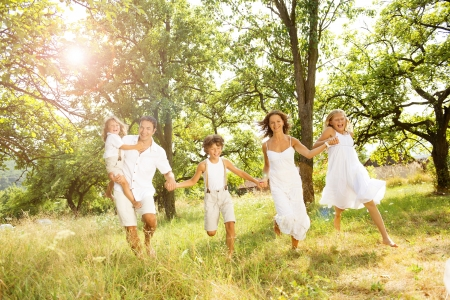 Photo pour Happy young family spending time outdoor on a summer day - image libre de droit