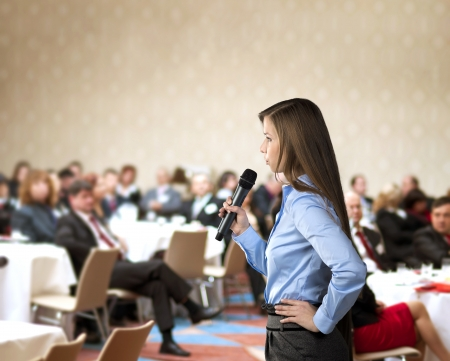 Photo for Beautiful business woman is speaking on conference  - Royalty Free Image