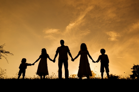 Photo for Silhouettes of happy parents having fun with their children - Royalty Free Image